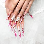 stock photo of nail-design  - Wedding art design nails on hands bride - JPG