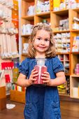picture of pigment  - Child with color or paint pigments in store - JPG