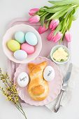 stock photo of easter eggs bunny  - Easter breakfast table with Easter eggs - JPG