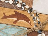 foto of mother-of-pearl  - marine theme in interior design with wooden flooring with inlaid dolphin aged ceramic tiles mother of pearl beads wood and twine salted - JPG