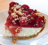 stock photo of crust  - Thick piece of cheesecake with cherries and graham cracker crust - JPG