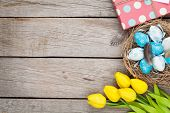 foto of gift basket  - Easter background with blue and white eggs in nest - JPG