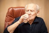 picture of glass water  - old man drinking a glass of water - JPG