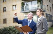 stock photo of presenter  - Real estate agent presenting a new apartment - JPG