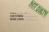 image of offensive  - Paper texture with green Not guilty rubber stamp court folder - JPG