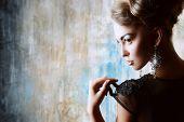 picture of slim model  - Stunning female model in black evening dress - JPG