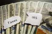 pic of irs  - Taxes and IRS paper notes on money - JPG