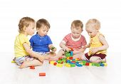 stock photo of little kids  - Children Group Playing Toy Blocks - JPG