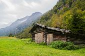 image of wooden shack  - Landscape with a wooden house in the mountains - JPG