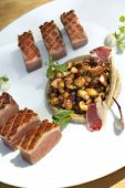 image of duck breast  - Duck breast puree ham and mushrooms on a plate - JPG