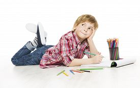 stock photo of creativity  - Little Child Boy Drawing by Pencil Artistic Creative Kid Thinking and Dreaming Idea Creativity Early Education Concept - JPG