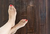 pic of painted toenails  - A beautiful Woman painting toe nails pedicure - JPG