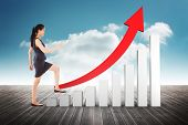 pic of step-up  - Businesswoman stepping up against cloudy sky background - JPG