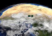 picture of nigeria  - Nigeria flag on pole on earth globe illustration  - JPG