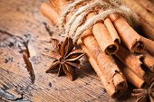 picture of christmas spices  - Clove and cinnamon closeup on wood background - JPG