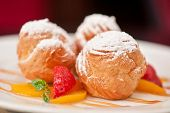 foto of condensation  - profiteroles from cream and condensed milk decorated with strawberry and peach - JPG