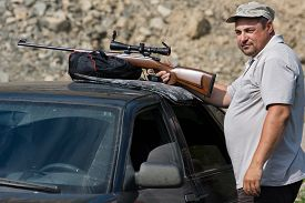 picture of shooting-range  - the man shooting from a rifle on the shooting - JPG