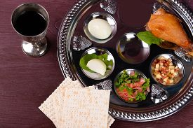 pic of seder  - Matzo for Passover with Seder meal with wine on plate on table close up - JPG