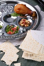 stock photo of seder  - Matzo for Passover with Seder meal on plate on table close up - JPG