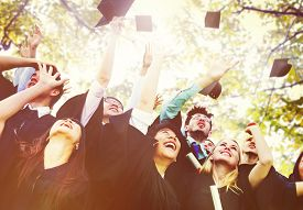 stock photo of graduation gown  - Diversity Students Graduation Success Celebration Concept - JPG