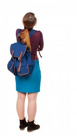 image of up-skirt  - Back view of  woman with backpack looking up - JPG