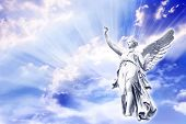 stock photo of archangel  - beautiful angel in blue and pink rays - JPG