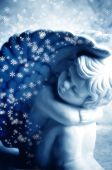 little angel with snow flakes in blue tonality