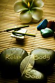 thee massage stones - relax, body, soul - and candle, aroma sticks and healing stones like a concept
