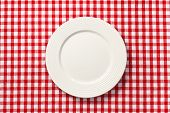 the white plate on checkered tablecloth