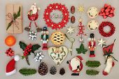 Christmas decorations with food, flora, bows and traditional symbols forming an abstract background. poster