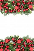 Christmas decorative background border with red bauble decorations, winter flora of holly berries, s poster