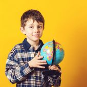 Curious Boy Holding Earth Globe Map. Little Traveler, Isolated On Yellow. Kid Exploring The New Hori poster