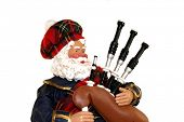 picture of bagpiper  - A Christmas figurine of a Scottish Santa bagpipe player - JPG