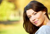 foto of single woman  - woman portirat smiling outdoors on a sunny day - JPG