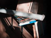 A Roll Of Canvas And Artist Equipment In A Loft, Contrast Indoor Shot poster