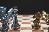 Strategy Of Strong Leadership As King And Weak Leadership As Horse Facing Each Other In Wooden Chess poster