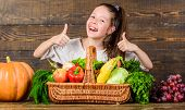 Child Show Thumbs Up Celebrate Harvest Holiday Vegetables Basket. Harvest Festival Concept. Girl Kid poster