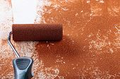 Painting Roller  Surface Copper Paint  Inside In Apartment Close Up. poster