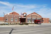 picture of firehouse  - Modern Fire station with Ambulance parked in front - JPG