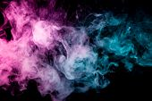 Textural Background For Creativity . Dense Multicolored Smoke Of   Blue And Pink Colors On A Black I poster