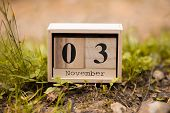 November 3rd. Day 3 Of November Set On Wooden Calendar On Wooden Plank Background. Autumn Time poster