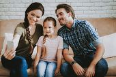 Family Makes Selfie. Smiling Little Girl. Smiling Family At Home. Smiling Person. Family With Child. poster