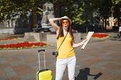 Funny Traveler Tourist Woman In Yellow Clothes, Orange Heart Glasses With Suitcase City Map Photo Ca poster