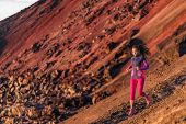 Runner athlete running on mountain trail. Young woman ultra run athlete running fitness workout. Hea poster