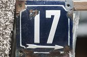 Weathered Grunge Square Metal Enameled Plate Of Number Of Street Address With Number 17 Closeup poster