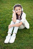 Positive Influence Of Music. Child Girl Enjoying Music Modern Earphones. Childhood And Teenage Music poster