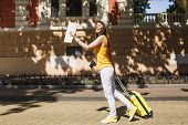 Joyful Traveler Tourist Woman In Yellow Summer Casual Clothes Hat With Suitcase City Map Walking In  poster