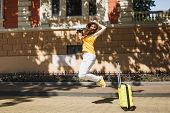 Young Pretty Traveler Tourist Woman In Yellow Summer Casual Clothes, Hat With Suitcase City Map Jump poster
