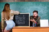 School Discipline And Behaviour Rules. Teacher Indignant Sit Table Chalkboard Background. Student In poster