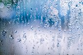 Misted Glass With Water Drops On Blue Background poster